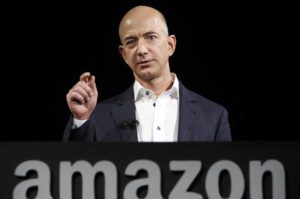 File- This Sept. 6, 2012, file photo shows Jeff Bezos, CEO and founder of Amazon, (AP Photo/Reed Saxon, File)